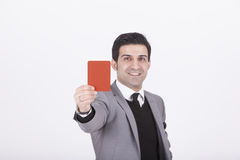 stock image of  businessman showing red card