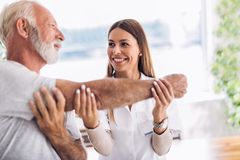 stock image of  man having chiropractic arm adjustment.