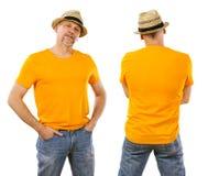 stock image of  man in his forties wearing blank orange shirt