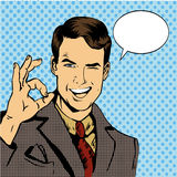stock image of  man smile and shows ok hand sign with speech bubble. vector illustration in retro comic pop art style
