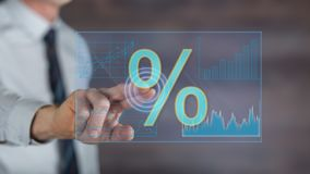 stock image of  man touching digital interest rates data on a touch screen