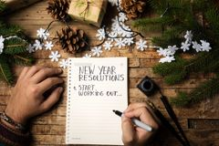 stock image of  man writing new year resolution on paper