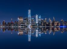 stock image of  manhattan skyline reflection from the jersey city, nj