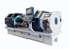 stock image of  manufacturing cnc professional lathe machine isolated on a white background. industrial concept.