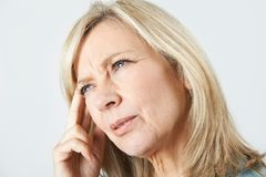 stock image of  mature woman suffering from memory loss