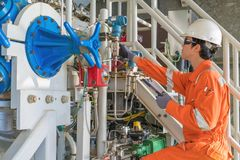 stock image of  mechanical engineering inspector check pressure of gas booster compressor engine before startup.