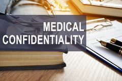 stock image of  medical confidentiality. documents with personal information in a clinic.