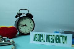 stock image of  medical intervention planning on background of working table with office supplies.