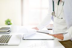 stock image of  medical technology , close up doctor reading a report in tablet.