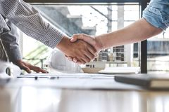 stock image of  meeting and greeting, two engineer or architect meeting for project, handshake after consultation and conference new project plan