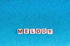 stock image of  melody word on stone