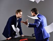 stock image of  men in suit or businessmen with unhappy expression with paper