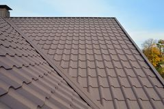 stock image of  metal roof construction against blue sky. roofing materials. metal house roof. closeup house construction building materials.