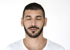 stock image of  middle eastern close eyes peaceful calm studio portrait