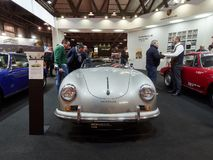 stock image of  milan, lombardy italy - november 23 , 2018 - visitors of autoclassica milano 2018 edition contemplate a classic silver porsche 356