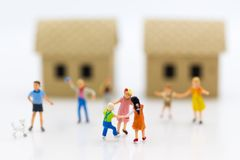 stock image of  miniature family: childrens playing together. image use for background international day of families concept