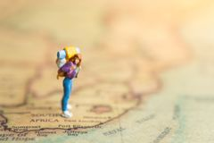 stock image of  miniature people : traveler walking on the map. used to travel to destinations on travel business background concept.