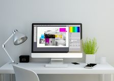stock image of  modern clean workspace with graphic design software on screen