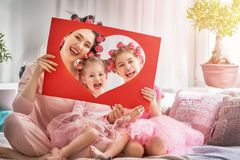 stock image of  mom and children doing hair