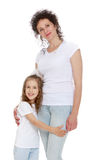 stock image of  mom and daughter in jeans