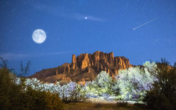 stock image of  moon rises over superstition mountains