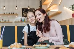stock image of  mother and daughter in cafe with desserts