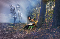 stock image of  mother and son reading fairy tales.