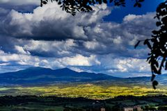 stock image of  mountains of tuscany. landscape of a cultivated grasslands.