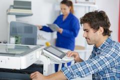 stock image of  multi-function office appliance technician
