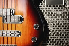 stock image of  music and entertainment. close up detailed view of a brown electric guitar body and amplifier standing in audio