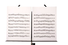 stock image of  music stand with melody sheets