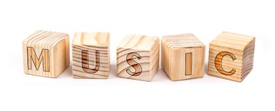 stock image of  music written on wooden blocks