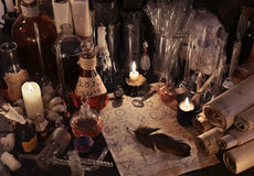 stock image of  mystic still life with alchemy paper, vintage bottles, candles and magic objects