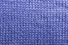 stock image of  needlework, hobbies, knitting. background textile fabric with a knitted texture wool blue