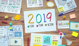 stock image of  2019 new year resolutions with business digital marketing and paperwork sketch on wood table.analysis strategy concepts