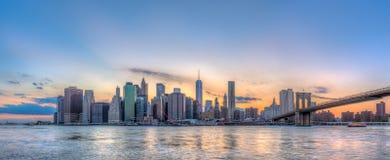 stock image of  new york city manhattan downtown skyline and brooklyn bridge