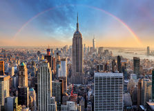 stock image of  new york city skyline with urban skyscrapers and rainbow.