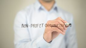 stock image of  non profit organization, man writing on transparent screen
