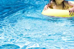 stock image of  not recognizable toddler child in a swimming pool