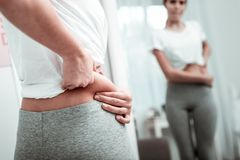 stock image of  young woman noticing fat on her waist