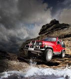 stock image of  offroad vehicle on the mountain terrain