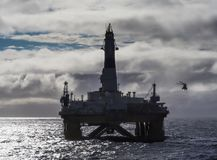 stock image of  offshore drilling rig in gulf of mexico, petroleum industry, with helicopter