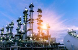 stock image of  oil industry refinery factory at sunset, petrochemic