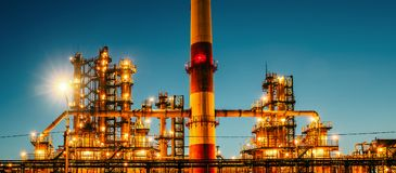 stock image of  oil refinery industrial plant or factory at sunset, storage distillery tanks and steel pipeline, modern petrochemical technologies