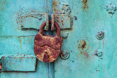 stock image of  old padlock on a blue door