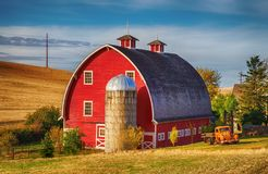 stock image of  red barn in the fall