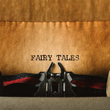 stock image of  old typewriter and text fairy tales