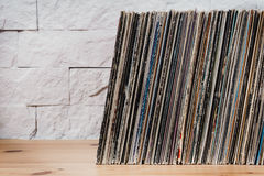 stock image of  old vinyl records in the wooden shelf