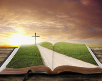 stock image of  open bible with road.