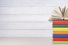 stock image of  open book, hardback books on wooden table. education background. back to school. copy space for text.